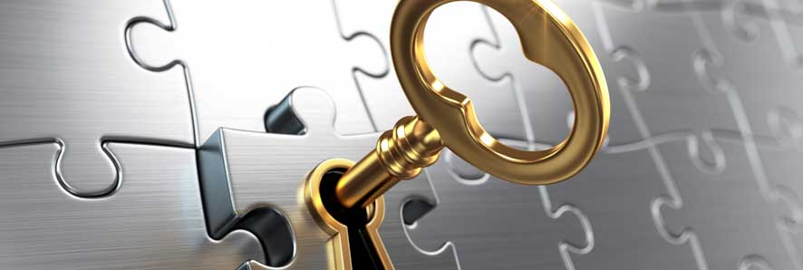 golden key with puzzle pieces